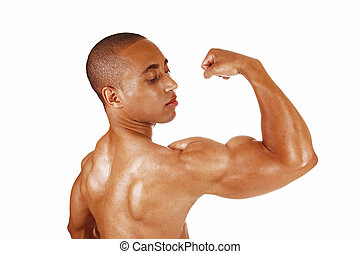 Guy showing his biceps - A very muscular young Jamaican...