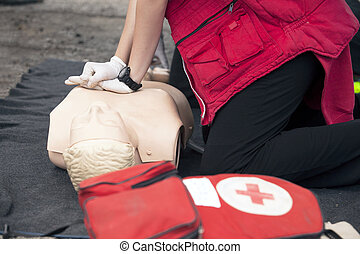 first aid training - Demonstrating CPR on a dummy