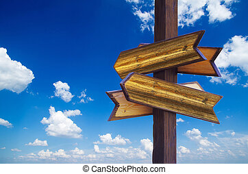 Wooden sign isolated on sky