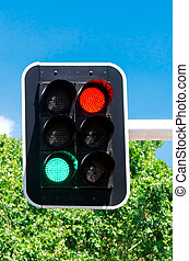 Red and green traffic lights on blue sky - Red and green...