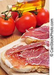 spanish pa amb tomaquet with serrano ham - closeup of...