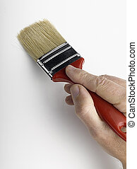 Man painting a wall with a brush
