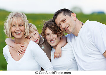 family embracing each other - portrait of a family in nature...