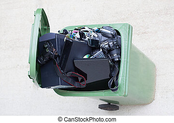 Bird eye view of dustbin with broken old electronics