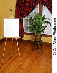 blank canvas and subject - empty white canvas and easel in...