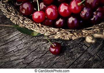 Fresh cherry - Fruit food concept. Fresh cherries on wood