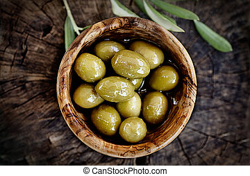Fresh olives on rustic wooden background Olives in olive...