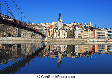 Famous view of Saone river and footbridge in Lyon city,...