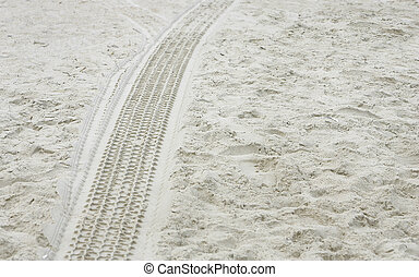 tire tracks on the sand - imprint of a tire track on clean...