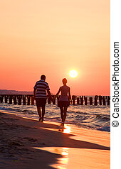 Austria sunset - Austria : a couple on the beach in sunset