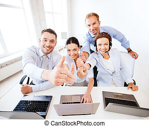 group of office workers showing thumbs up - business concept...