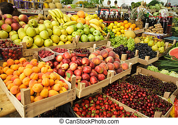 Fruits on the market - Various fresh fruits in boxes on the...