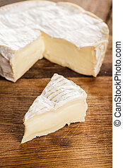 camembert slice closeup - camembert cheese slice over the...