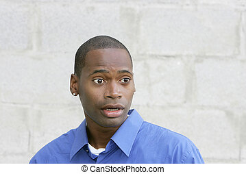 surprised guy portrait - one surprised African American guy...