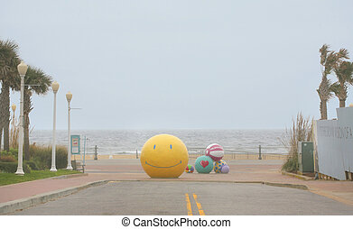 smiley face ball - yellow smiley face ball in front of the...