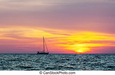 Silhouette of the yacht at sunset
