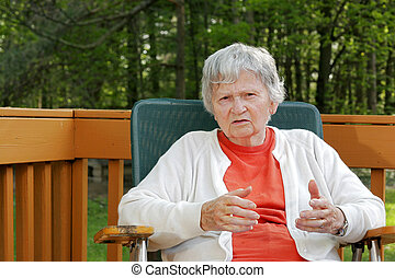 elderly woman telling a story - an older lady relaxing...