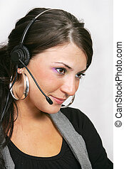 customer service woman with headset - a young, beautiful...