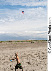 Flying a kite - A young boy flying a kite