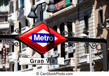 Metro Sign Gran Via on blurred city, Madrid