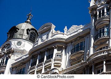Old ornamental building at Gran Via in Madrid, Spain
