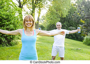 Personal trainer with client exercising outside - Female...