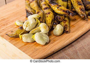 Grilled marinated fava beans on board - Fresh grilled...