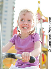 Little girl having fun in amusement park