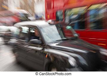 Motion blur picture of Black Cab and Red Double Decker Bus...