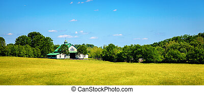 Horse farm - Scenic image of a horse farm with stables and...