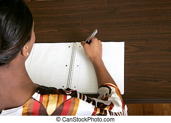 businesswoman writing notes - African American female...