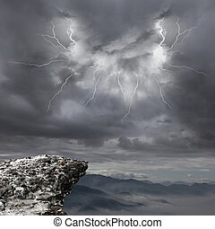 danger precipice on the mountain with rainstorm clouds and...