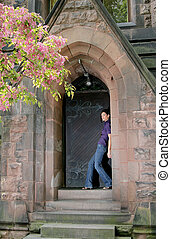 woman in the church doorway - beautiful model leaning into...