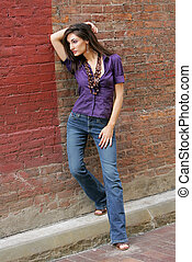 woman leaning on the wall - gorgeous fashion model leaning...