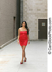 woman in red dress - sexy African American woman walking...