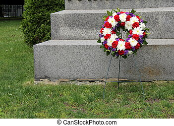 Memorial wreath at gravesite - Memorial wreath set on stand...