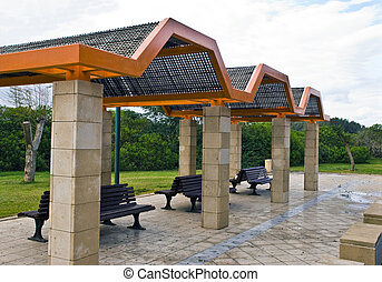 Resting place - Row of benches under the awning that makes...
