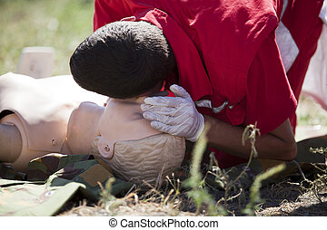 first aid training - CPR practitioner examining eirways on...