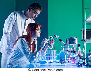 scientists studying a molecular structure - side view of two...