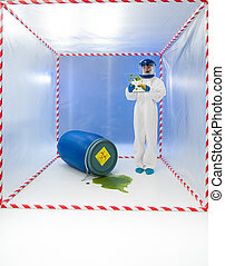biohazar accident - female specialist standing in a cube...
