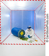 Woman in a biohazard suit testing a spillage of green liquid...