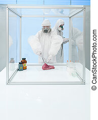 experimenting on raw meat in sterile chamber - scientist...
