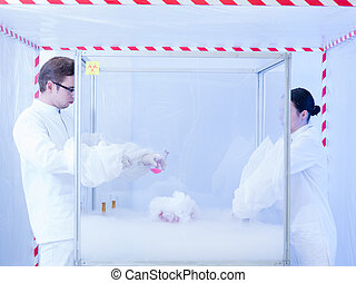 experimenting with liquid nitrogen in containment tent - two...