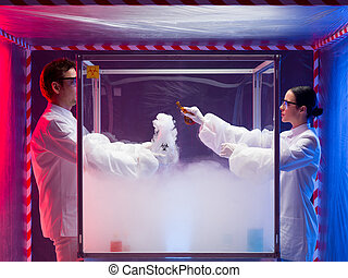 two scientists experimenting with steamy reactions - two...