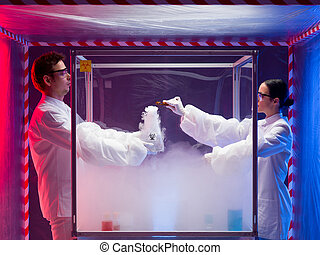 chemical reactions in sterile chamber - two scientists, a...