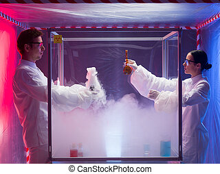 mixing chemical substances in sterile chamber - two...