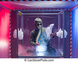 man experimenting inside protection enclosure - a person...