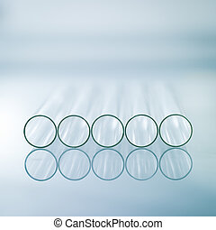 Horizontal empty glass test tubes - A close-up of five...