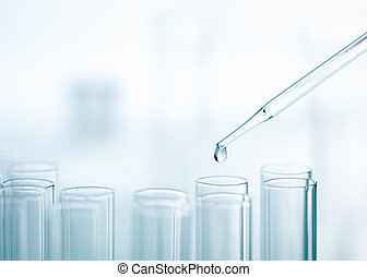 Liquid drop from pipette to test tube - A close-up of a...