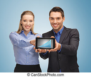 two business people showing tablet pc with graph - picture...